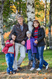 Four people family full length portrait in autumn park Royalty Free Stock Photo