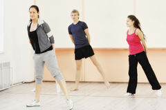 Four people in gym Stock Photography