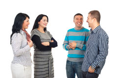 Four people having conversation. Four friends having a funny conversation and laughing or men flirting with women isolated on white background Stock Photos