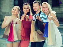 Four people holding paper bags Royalty Free Stock Image