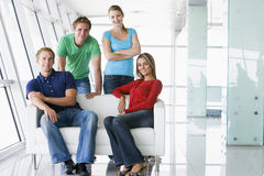 Four people in lobby smiling Stock Image