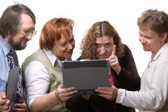 Four people looking at laptop Stock Photography