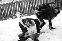 Four people playing in snow Stock Image