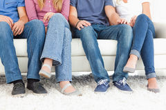 Four people sitting on the couch  Stock Photos