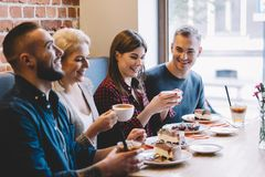 People eating in a restaurant, laughing Royalty Free Stock Images