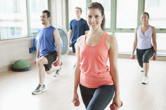 Four people stretching in aerobics class Royalty Free Stock Photo