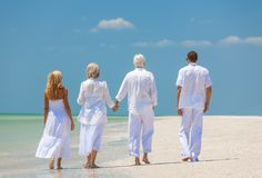 Four People, Two Seniors, Family Couples, Walking On Tropical Be Stock Photography