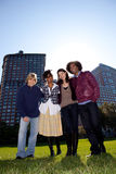 Four People in Urban Park Royalty Free Stock Photo