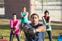 Four People Using Weights Royalty Free Stock Image