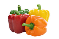 Four Peppers. Multi Colored Isolated On White Background stock images