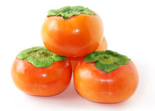Four persimmons Royalty Free Stock Images
