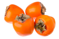 Four persimmons. Four persimmons closeup isolated on white background Stock Image