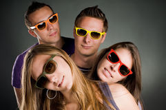 Four persons with colored. Group of four persons with multi colored sunglasses Stock Photos