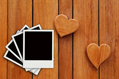Four photo on hearts wooden background Royalty Free Stock Photo