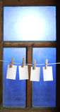 Four photo paper attach to rope with clothes pins Royalty Free Stock Image