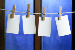 Four photo paper attach to rope with clothes pins Stock Photo
