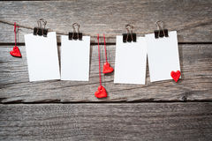 Four photo paper attach to rope with clothes Stock Image