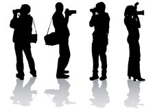 Four photographers Stock Images