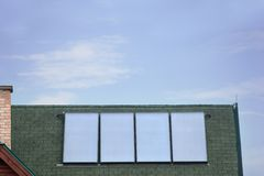 Four photovoltaic solar panels on rooftop Royalty Free Stock Image
