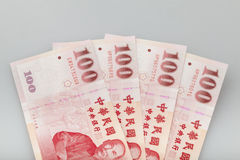 Four piece of one hundred dollar of  New Taiwan Dollar cash. Close up with  gray background Stock Photo