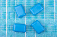 Four pieces of blue soap on checkered towel. Top view Royalty Free Stock Photography