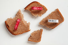 Four pieces of bread slice and seals. With printed production date Stock Photography