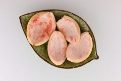 Four pieces of a grapefruit peel Royalty Free Stock Photo