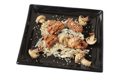 Four pieces of salmon with mushrooms Stock Photo