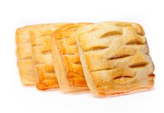 Four pies with cherry jam isolated Stock Image