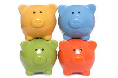 Four Piggy Banks Stacked Stock Photography
