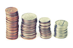 Four piles of coins Royalty Free Stock Image