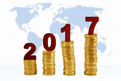 Four piles coins with numbers 2017 Stock Image