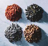 Four piles of superfoods on light background. Royalty Free Stock Photography