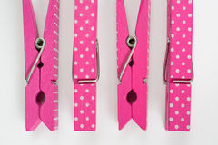 Four Pink Clothes Pins with Fun Patterns Two Flipped Top View Royalty Free Stock Photography