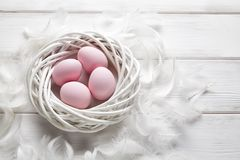 Free Four Pink Easter Eggs In The White Nest And Feathers Royalty Free Stock Image - 108737226