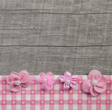 Four pink handmade flowers on wooden grey shabby chic background Royalty Free Stock Image