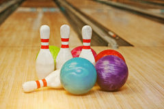Four pins with five bowling balls Stock Photo