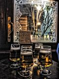 Four pints of beer in front of pub window in London royalty free stock photos