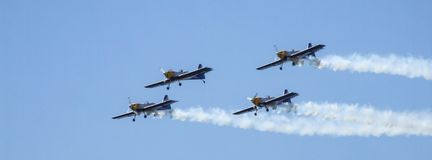 Four piston propeller aerobatic aicraft during display. royalty free stock image