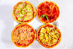 Four pizzas composition, top view Royalty Free Stock Photography