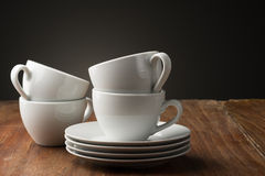 Four plain white ceramic coffee cups Royalty Free Stock Photo