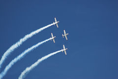 Four planes. Fly in formation with vapor trails royalty free stock images