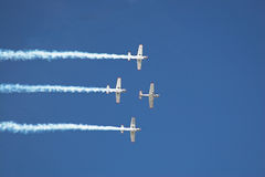 Four planes 2. Four planes fly in formation with vapor trails Stock Image