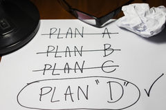 Four Plans ,change of plan Stock Photo