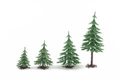 Four plastic fur-trees on white Stock Images
