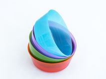 Four plastic round medium size bowls for loose products isolated on a white background stock image