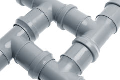Four plastic sewer pipes composition closup Stock Photos