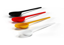 Four plastic spoons Royalty Free Stock Images