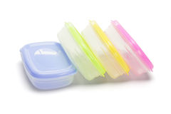 Four plastic storage containers Stock Photos