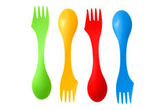 Four plastic varicolored camping cutlery tools spoons and forks Royalty Free Stock Image